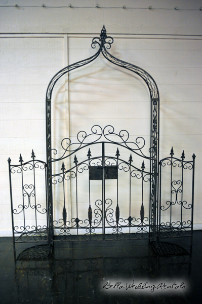 wroought iron wedding arch with fence